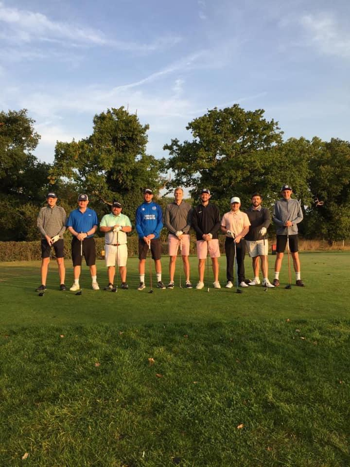 picture of danial jack and friends lining up after the charity golf match