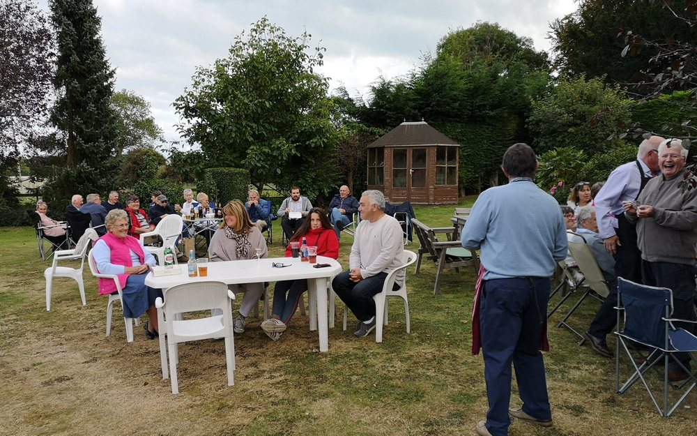 Picture of members gathered for the BBQ having a good time.