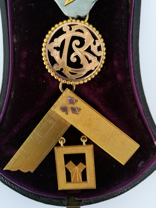 Close up of the lower section, depicting the initials and inscription to whom the jewel was issued.