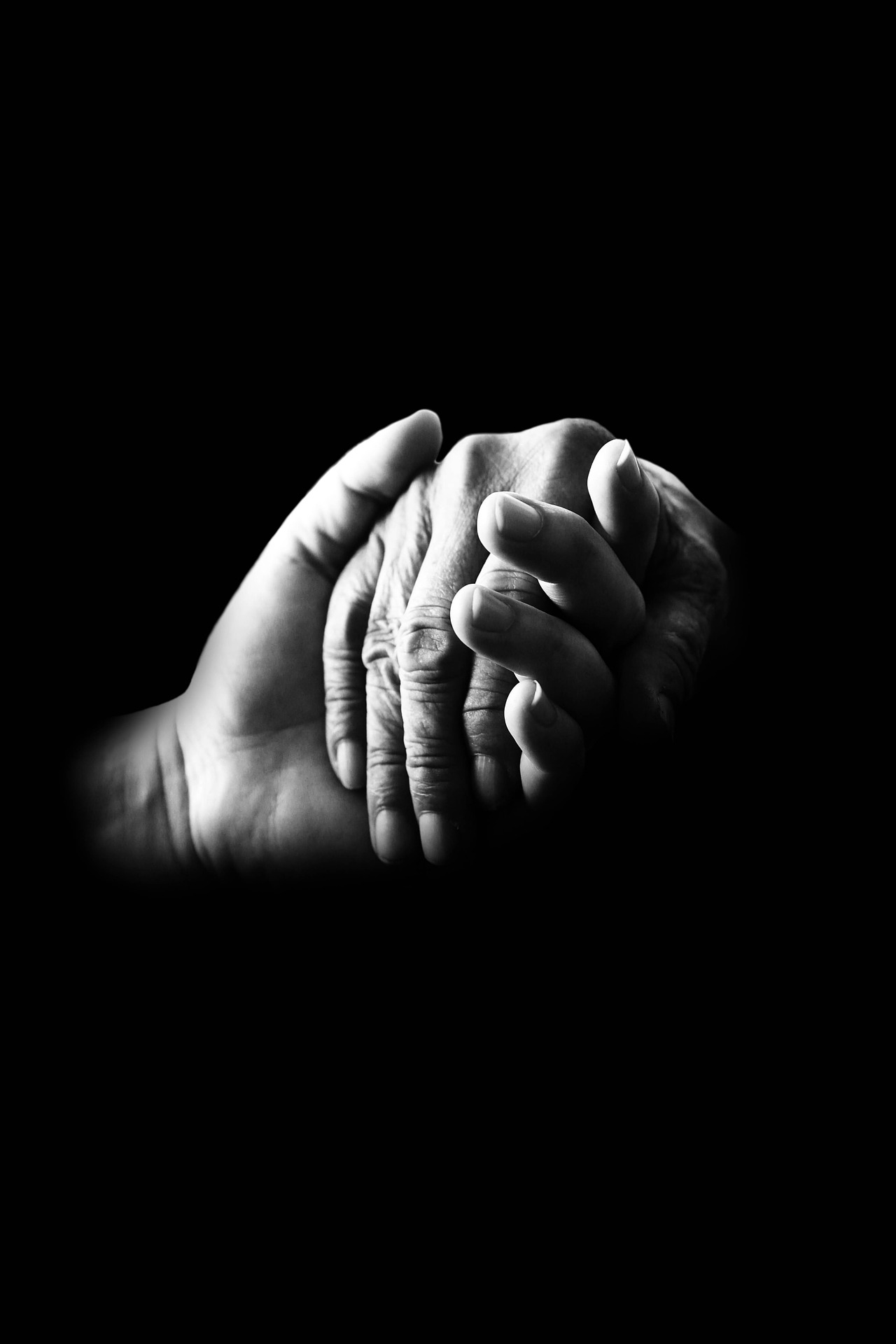 picture of two hands, one hand holding the other